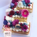 Baby shower cake, first birthday cake, ombre rosettes cake, letter and number custom cakes and pastry tarts and cupcakes located in Huntington Beach, Orange County, California.